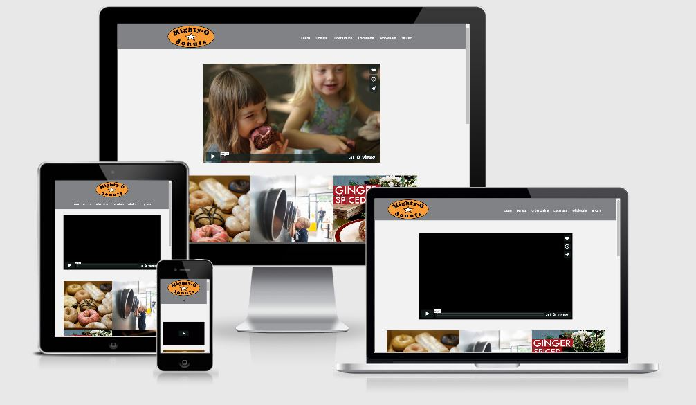 A photo of various views of the Mighty-O website. Designed by WebCami.