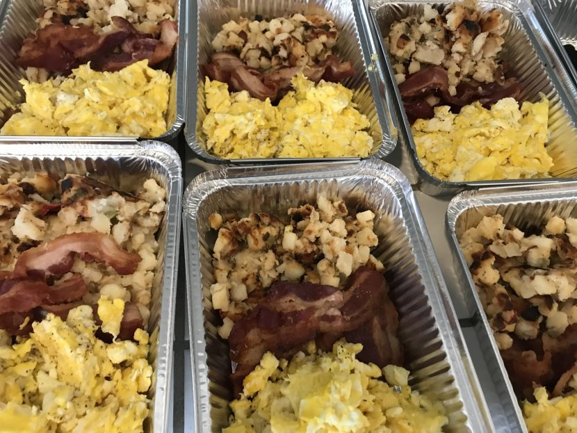 food trays with breakfasts