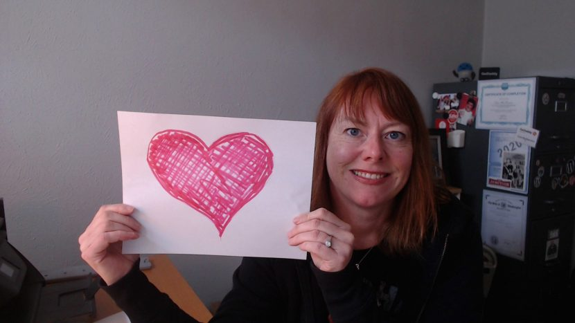 WebCami holding a heart and sending love to clients and friends
